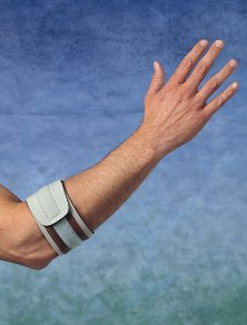 In the treatment of epicondylitis wearing retainer brace helps eliminate stress and pain in his forearm.
